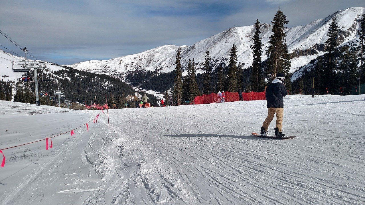 A snowboarder at Arapahoe Basin ski area on opening day 10/29/15