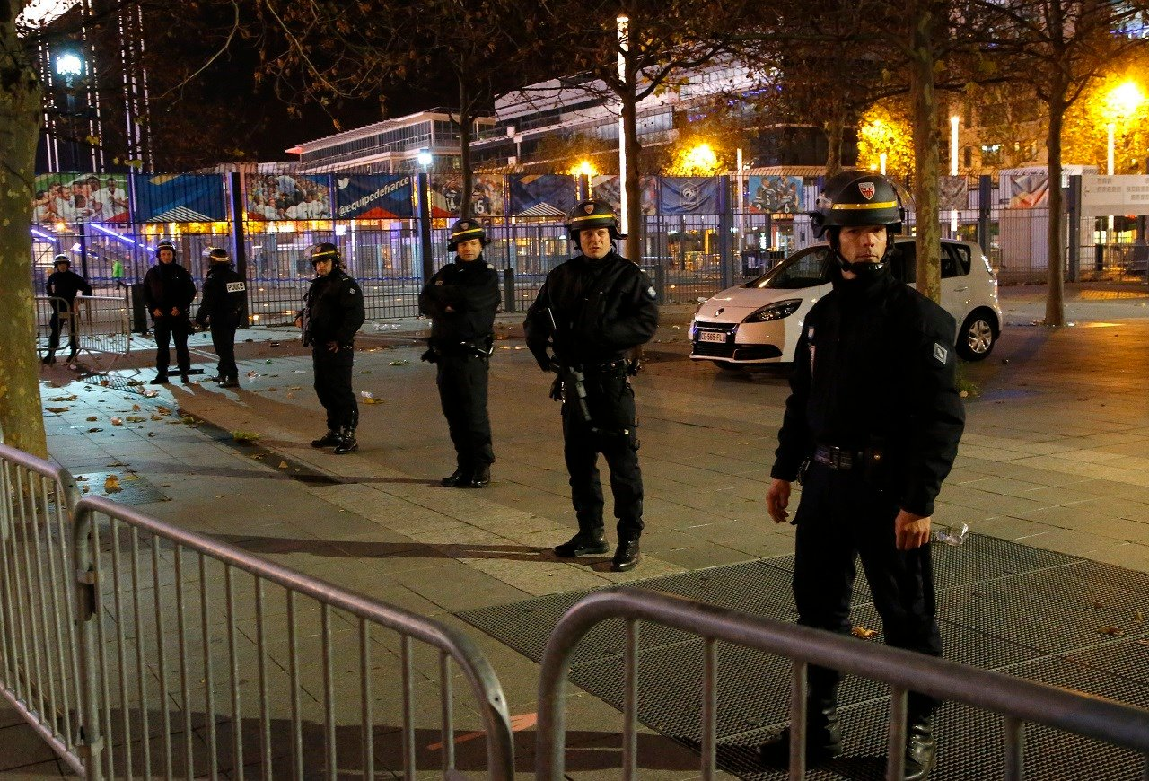 Police officers secure the Stade de France stadium during the international friendly soccer France against Germany, Friday, Nov. 13, 2015 in Saint Denis, outside Paris.