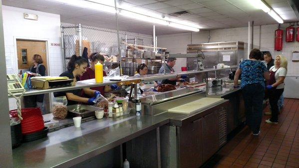 Volunteers prepare turkeys and potatoes for Thanksgiving in Pueblo