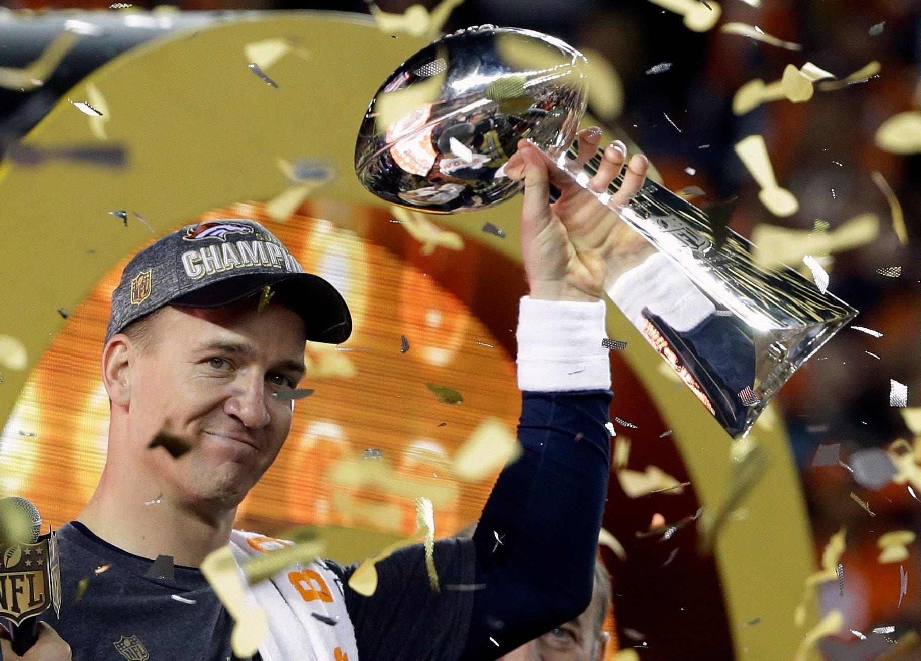 Broncos quarterback Peyton Manning hoists the Vince Lombardi Trophy after Denver won Super Bowl 50 Sunday.