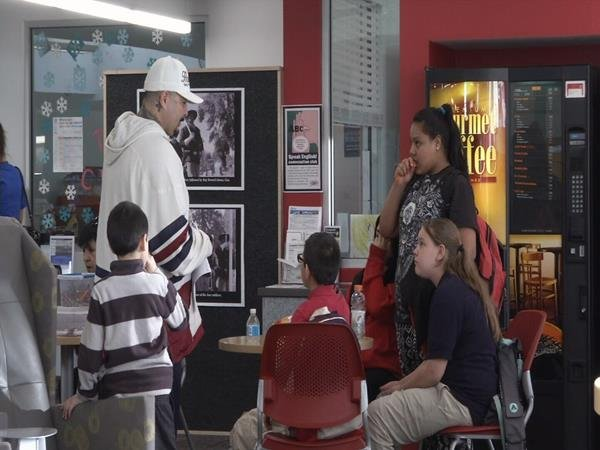 Former gang member-turned-certified addiction counselor Mark Salazar talks to kids at the Lucero library