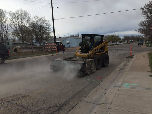 Crews put down a temporary fix over a gas line repair on Acero Avenue.